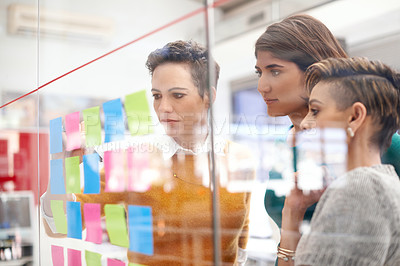 Buy stock photo Cropped shot of three businesswomen working in the office