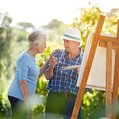 Buy stock photo Cropped shot of a senior couple painting in the park