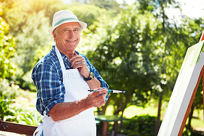 Buy stock photo Cropped portrait of a senior man painting in the park