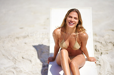 Buy stock photo High angle portrait of a young woman relaxing at the beach