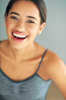 Buy stock photo Cropped shot of a sporty young woman posing against a grey background