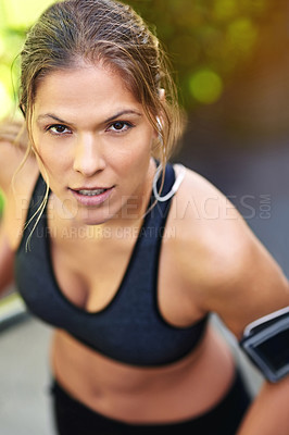 Buy stock photo Cropped portrait of an attractive young athlete exercising outdoors