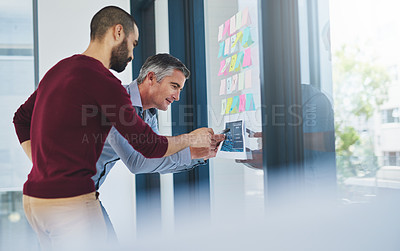 Buy stock photo Cropped shot of two businessmen working in the office