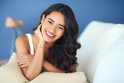 Buy stock photo Portrait of a young woman lying on her living room sofa