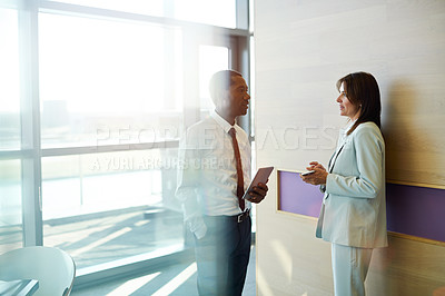 Buy stock photo Cropped shot of two businesspeople talking in an office