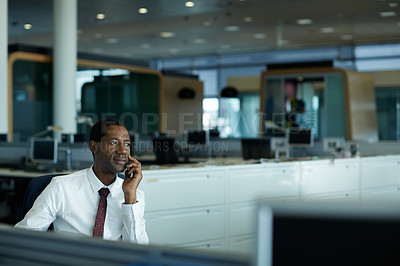 Buy stock photo Shot of a businessman using his cellphone in an office