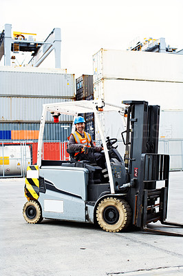 Buy stock photo Shot of a forklift operator working on a large commercial dock
