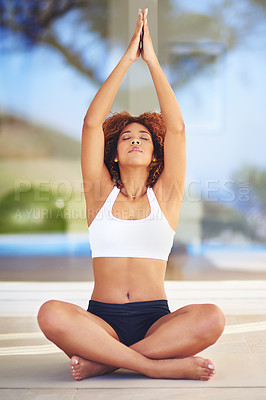 Buy stock photo Shot of a young woman practising her yoga routine