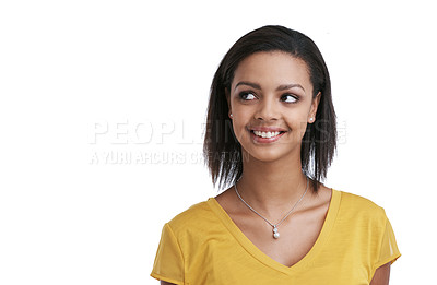 Buy stock photo Studio shot of a young woman looking thoughtful against a white background
