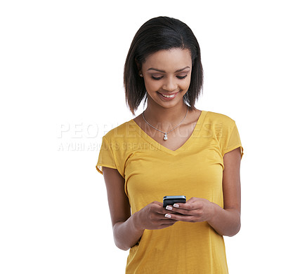 Buy stock photo Studio shot of a young woman using a cellphone against a white background