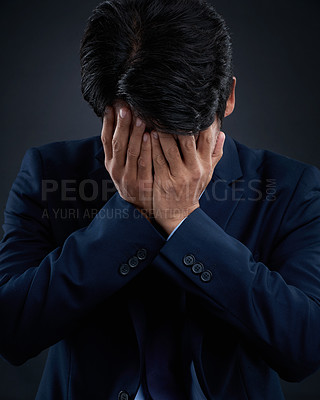 Buy stock photo Studio shot of a businessman having a breakdown against a dark background