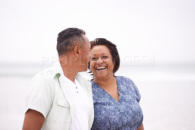 Buy stock photo Shot of a happy mature couple at the beach on a misty morning