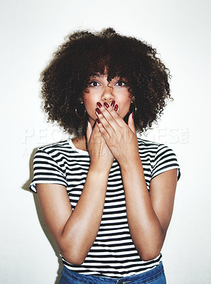 Buy stock photo Studio shot of an attractive young woman looking shocked against a gray background