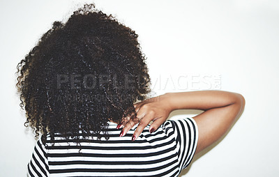 Buy stock photo Rearview studio shot of a woman touching her back against a gray background