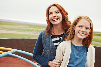 Buy stock photo Shot of a mature woman and her young daughter at the park