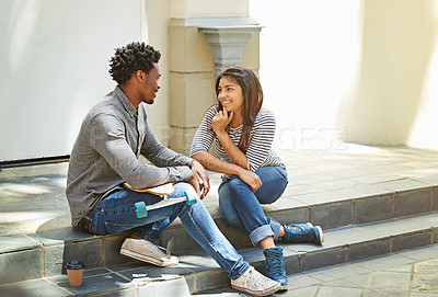 Buy stock photo Shot of a young skater couple hanging out in the city
