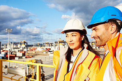 Buy stock photo Shot of two workers standing in a dockyard