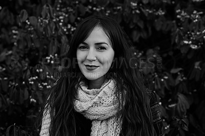Buy stock photo Black and white shot of a young woman standing against a nature background