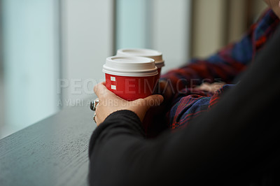 Buy stock photo Cropped shot of a couple on a coffee date at a cafe