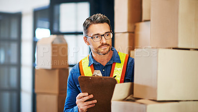 Buy stock photo Cropped shot of a man working in a warehouse