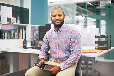 Buy stock photo Portrait of a successful young man working in a modern office