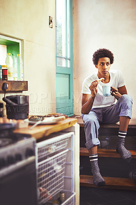 Buy stock photo Shot of a young man having breakfast at home