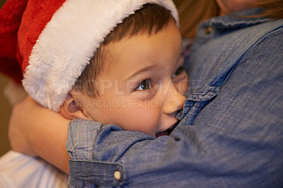 Buy stock photo Shot of a young brother and sister playfully hugging at home during ChristmasKids at home on Christmas