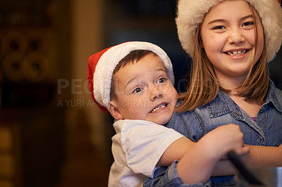 Buy stock photo Shot of a playful brother and sister at home during Christmas