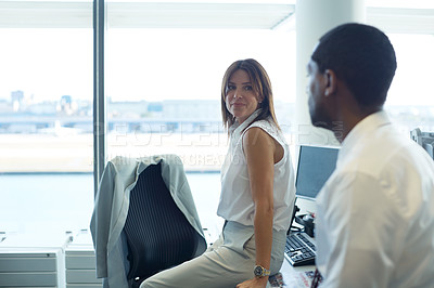 Buy stock photo Shot of two coworkers talking together in an office