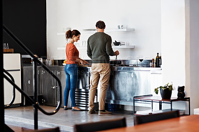 Buy stock photo Rearveiw shot of a mature couple cooking in their kitchen