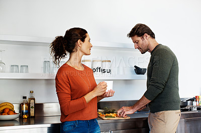 Buy stock photo Shot of a smiling mature couple cooking together in the kitchen