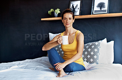 Buy stock photo Portrait of a smiling mature woman drinking coffee while sitting on her bed