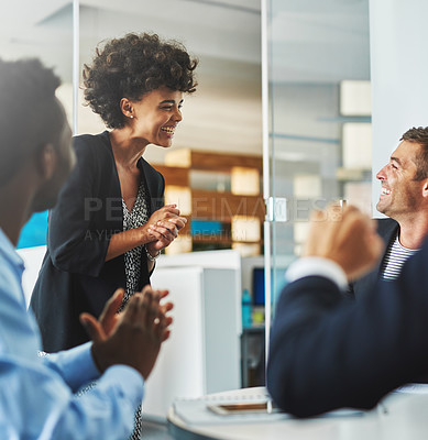 Buy stock photo Shot of colleagues laughing together in an office