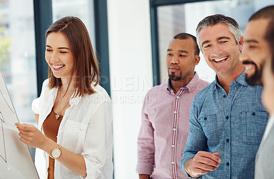 Buy stock photo Cropped shot of four businesspeople working at a whiteboard