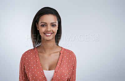 Buy stock photo Studio portrait of an attractive young woman posing against a grey background