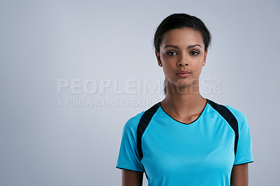 Buy stock photo Studio portrait of a sporty young woman posing against a gray background