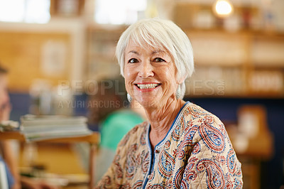 Buy stock photo Portrait of a smiling senior woman in a cafe