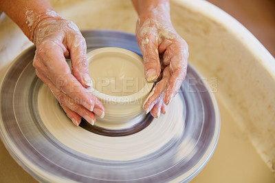 Buy stock photo Cropped shot of a woman making a ceramic pot in a workshop
