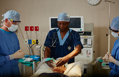 Buy stock photo Shot of a surgeon administering anesthetic to a patient before her surgery