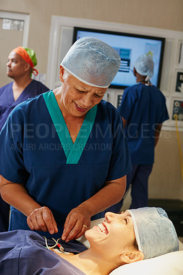 Buy stock photo Shot of a surgeon preparing a patient for her surgery