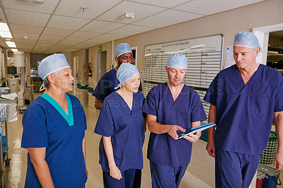 Buy stock photo Cropped shot of a medical team standing in a hospital