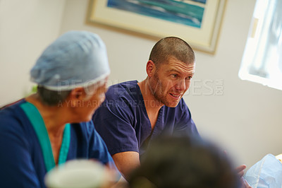 Buy stock photo Shot of medical practitioners having a chat while on their tea break