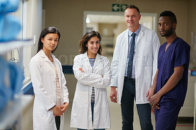 Buy stock photo Portrait of a medical team standing together in a hospital
