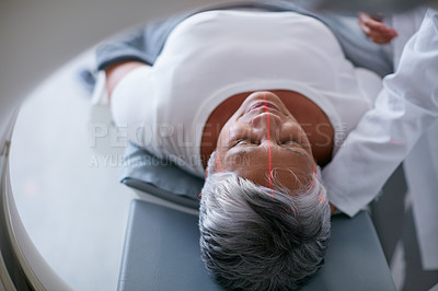 Buy stock photo Shot of a senior woman about to have an MRI scan