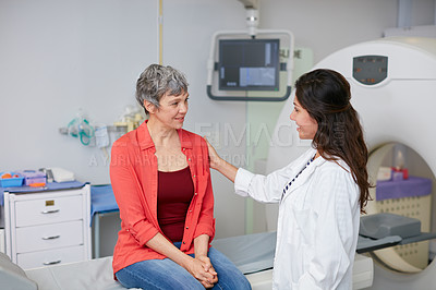 Buy stock photo Shot of a mature woman being comforted by a doctor before and MRI scan