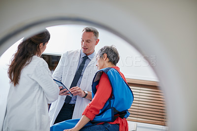 Buy stock photo Shot of a mature woman talking with doctors before and MRI scan