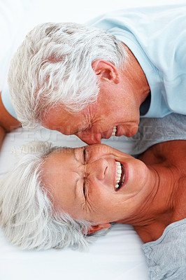 Buy stock photo Closeup of senior man expressing his love towards the woman in bed