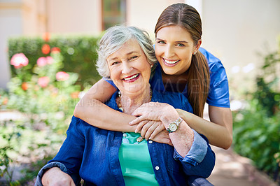 Buy stock photo Shot of a resident and a nurse outside in the retirement home garden
