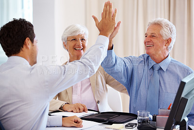 Buy stock photo Senior couple at financial adviser's office with man giving high five to business consultant