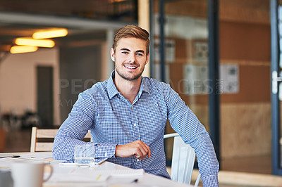 Buy stock photo Portrait of a successful young businessman working in an office